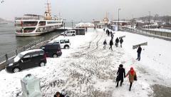 Eminonu Ferry Port in a snowy winter day Stock Footage