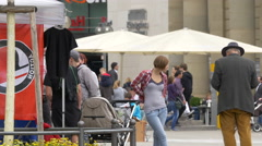 Two families with baby strollers standing near Konigsbau Passagen, Stuttgart Stock Footage