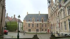 Monumental building in Bruges, person walks to entrance Stock Footage
