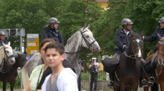 Police riot with horses safeguard the perimeter and people passing by, Stuttgart Stock Footage