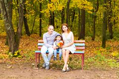 Young family for a walk in the autumn park with baby Stock Photos