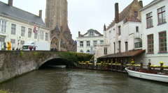 From canal bridge to church belfry tower Stock Footage