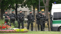 German riot police stand in line during Gay Pride in Stuttgart Stock Footage