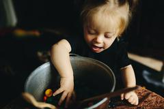little girl playing in a witch - stock photo