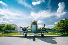 Lisunov Li-2 of Soviet Air Force standing near building Beloruss Stock Photos