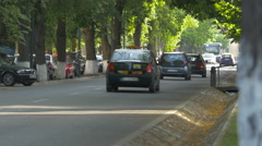 WDriving cars and bus near Central Park, Cluj-Napoca Stock Footage