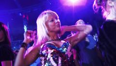 Blonde girl in a brilliant dress dancing in the club at the party - stock footage