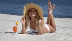 Girl in straw hat sunbathing on beach - stock footage