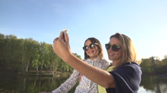 Mother and daughter hugging and taking selfies in the Park Stock Footage