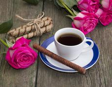 Coffee still life, cookies in the form of sticks and a rose on each side Stock Photos