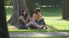 WTwo girls eating ice cream in Central Park, Cluj-Napoca Stock Footage