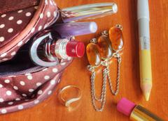 Make up bag with cosmetics - stock photo