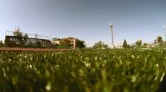 Teen athlete runner boy running on treadmill stadium sun sunny day healthy Stock Footage