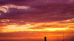 Sunrise Time Lapse with Building Silhouette and orange and purple skies Stock Footage