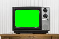 Old Portable Television on Wood Table with Chroma Key Green Scre - stock photo