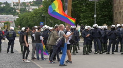 Waving a rainbow flag and dancing with others near the police forces,Stuttgart Stock Footage