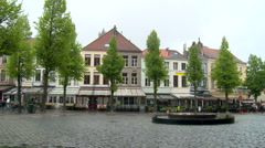 Nearly empty pedestrian square with bad weather, Bruges Stock Footage