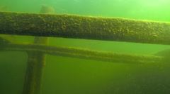 Underwater moving camera shot inside the cargo hold of a sunken boat Stock Footage