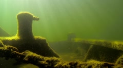 Bow side of an old underwater shipwreck deck with sun beams Stock Footage