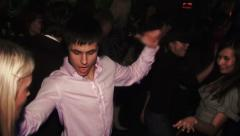 Guy in the white shirt in the club dancing at a party Stock Footage