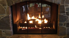 Double-sided field stone Fireplace at ski resort base lodge Stock Footage