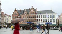 People passing by in Market Square, traditional Belgian buildings - stock footage