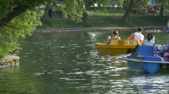 WFamilies pedaling the pedal boats in Central Park, Cluj-Napoca Stock Footage