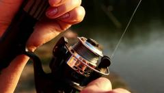Winding fishing line onto the spool fishing rods close-up Stock Footage