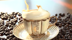 Sugar cubes splashing into coffee. Stock Footage