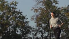 Running in the Park early in the morning, model 25, slo-mo Stock Footage