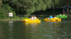 WPedaling the colored pedal boats from Central Park, Cluj-Napoca Stock Footage