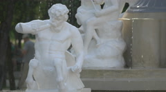 WWhite statues at a fountain in Central Park, Cluj-Napoca Stock Footage