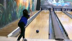 Cute Asian Girl Tries Bowling Stock Footage