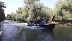 People take boat trip with a local ranger in the Danube Delta Biosphere Reserve Stock Footage