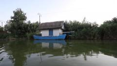 Traditional romanian old wooden house with a boat in front of it - stock footage