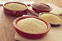 amaranth, quinoa, brown flax and buckwheat seeds - stock photo
