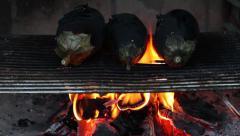 Roasting eggplants on grill - stock footage