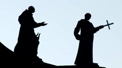 Church religious statues with crucifix and outstretched hand, silhouettes Stock Footage