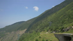 Walking on the road and admiring the view of Transfagarasan Stock Footage