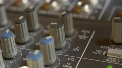 Sound mixing console buttons and dials close-up 4K 2160p 30fps UltraHD  Stock Footage