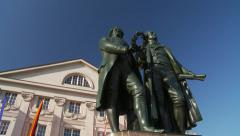 Goethe and Schiller statues in Weimar, pan from blue sky Stock Footage
