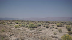Pan of A Roadside in the Desert Stock Footage