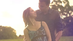 Romance of a young couple in love park  sunset slow motion lifestyle Stock Footage