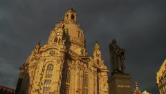 Stock Video Footage of Martin Luther statue in Dresden, tilt from Frauenkirche church of Our Lady