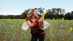 woman in bee costume in a meadow - stock footage
