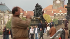 Trumpet musician in Europe, other buskers behind, pull focus Stock Footage