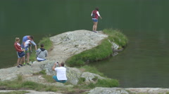 Relaxing on the lake shore on Transfagarasan Stock Footage