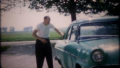 2588 - grandpa cleans 1955 Ford, family ready to go - vintage film home movie Stock Footage