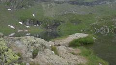 The beautiful glacial lake from Transfagarasan Stock Footage