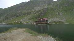 Great view of Balea Lake Chalet, on Transfagarasan Stock Footage